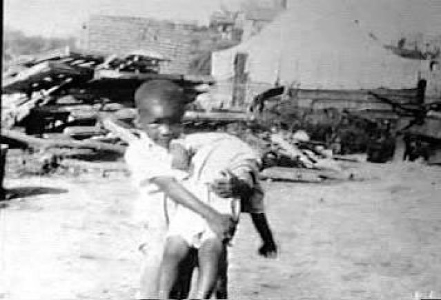 tulsa-race-riot-black-wall-street-child-carrying-child-060121